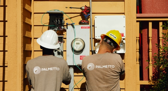Palmetto installers working on a house's electric panel